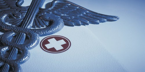 Caduceus with First-aid Kit --- Image by © Royalty-Free/Corbis